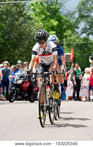 STILLWATER, MINNESOTA - JUNE 18, 2017: Pro cyclists on course at the 2017 North Star Grand Prix Women's Stillwater Criterium. It is the final stage of a six-stage annual race.