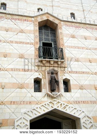 Statue of the young Mary and windows of Basilica of the Annunciation in Nazareth Israel