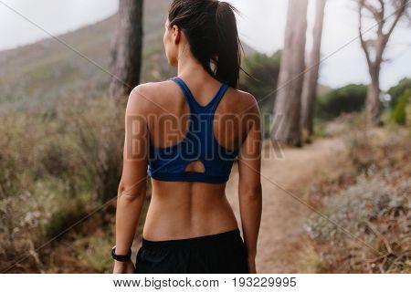 Young Asian Woman Walking On Mountain Trail