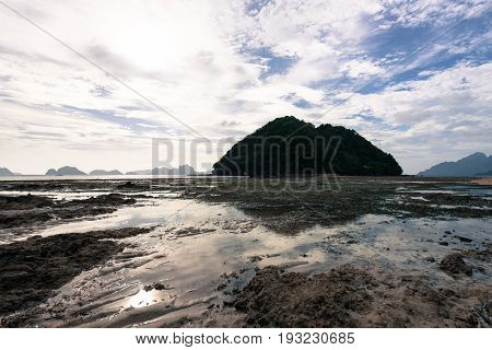 EL NIDO, PALAWAN, PHILIPPINES - MARCH 29, 2017: Horizontal picture of reflexing water of Las Cabanas Beach.