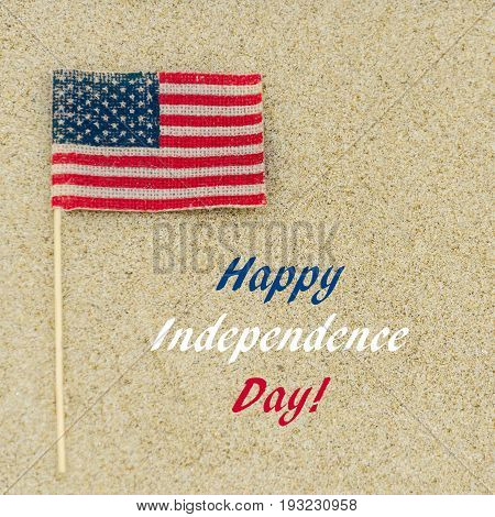 Independence USA background with American flag on the sandy beach square format
