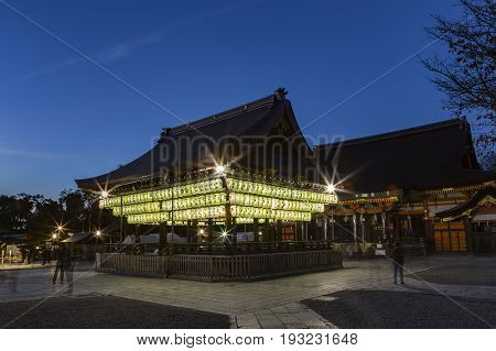 KYOTO JAPAN - NOV 20 2015: Unidentified tourists sightseeing Japanese paper lanterns illumination at the Buden Hall in Yasaka Shrine one of most famous shrines in Kyoto. Founded over 1350 years ago
