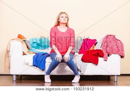 Woman Does Not Know What To Wear Sitting On Couch
