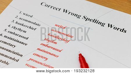 English spelling sheet on table with red pen