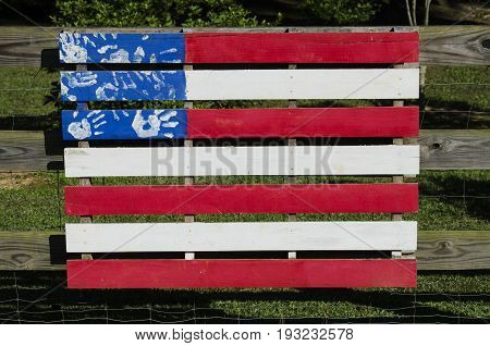 Painted fense section colored like the American Flag