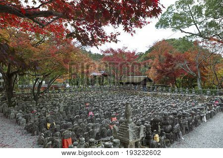 KYOTO JAPAN -NOV 24 2015: Buddhist stone statues in Adashino Nenbutsuji Temple Kyoto Japan in autumn. These statues placed in memory of those who died without kin since 1902