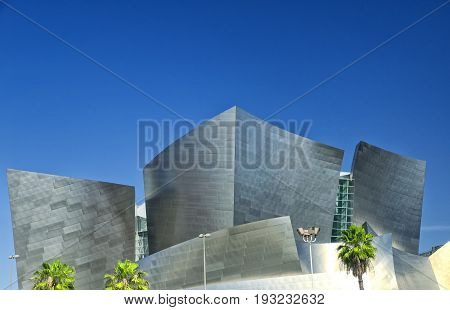 May 22 2017. Los Angeles California. A light post and palm trees in front of the landmark unique architecture of the walt disney hall designed by Frank Gehry in Los Angeles California.