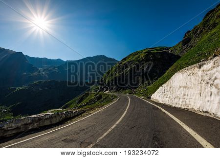 Asphalt Road Uphill Through Mountain Range