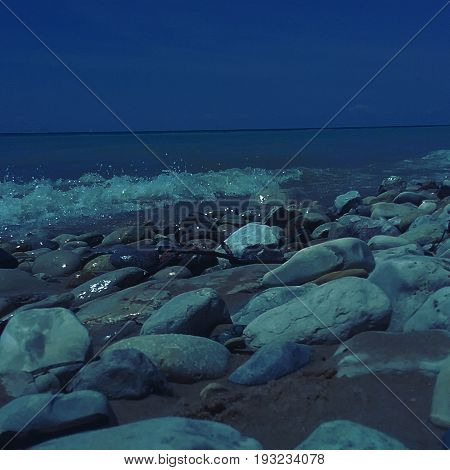 Rocks glistening in the moonlight by Lake Michigan.