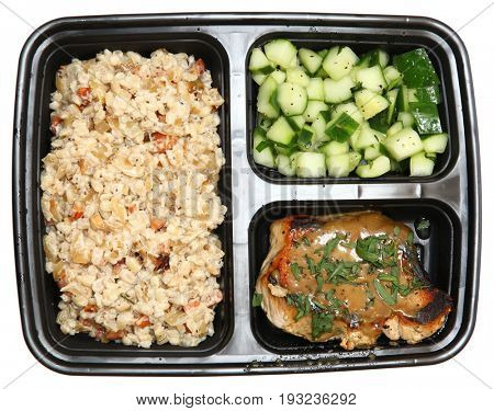 Pork Chops with Creamy Barley Salad and Marinated Cucumbers in a bento box.