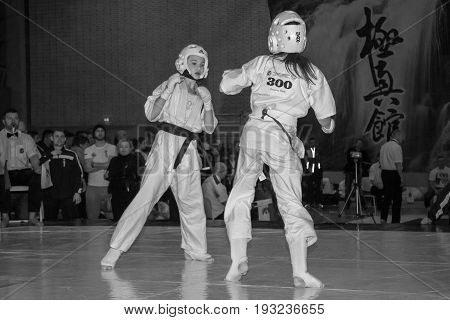 BERLIN - MARCH 18 2017: Girls-fighters on the tatami. Black and white. European championship Kyokushin World Union (KWU) for Children and Youth.