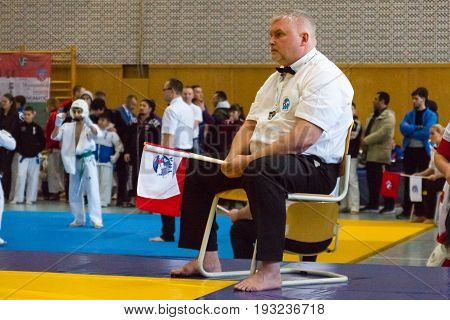 BERLIN - MARCH 18 2017: Referee on the tatami. European championship Kyokushin World Union (KWU) for Children and Youth.