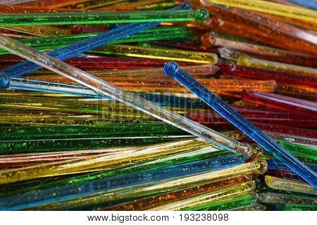 pile of assorted antique vintage glass swizzle sticks
