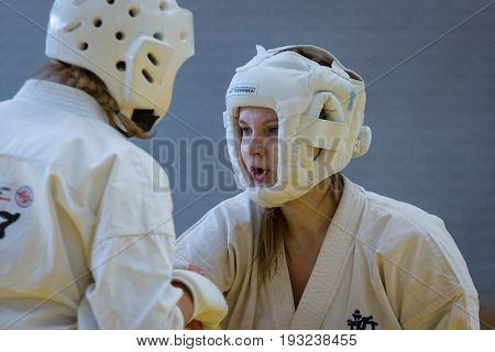BERLIN - MARCH 18 2017:Girls-fighters in protective helmets during a fight close-up. European championship Kyokushin World Union (KWU) for Children and Youth.
