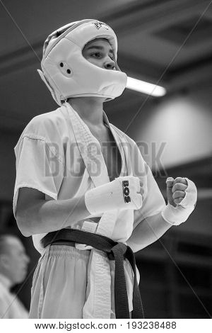 BERLIN - MARCH 18 2017: Fighters on the tatami. Close-up. Black and white. European championship Kyokushin World Union (KWU) for Children and Youth.