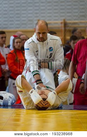 BERLIN - MARCH 18 2017: Coach adjusts athlete to fight. European championship Kyokushin World Union (KWU) for Children and Youth.