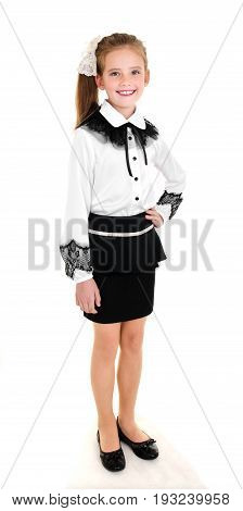 Portrait of happy smiling school girl child in uniform isolated on a white background education concept