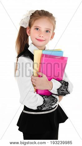Portrait of happy smiling school girl child with books in uniform isolated on a white background education concept
