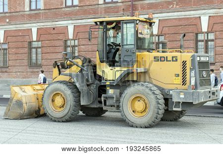 NIZHNY NOVGOROD, RUSSIA June 28, 2017 : Auto appliances communal services of the city. Grader, a machine for collecting large debris from the road surface.NIZHNY NOVGOROD
