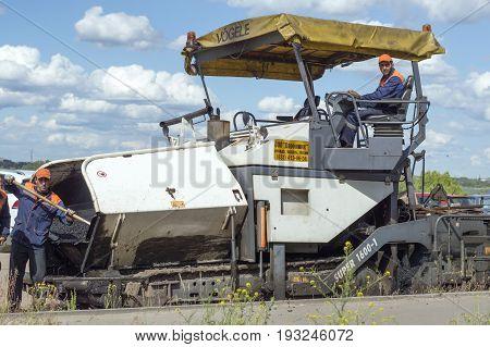 NIZHNY NOVGOROD, RUSSIA June 28, 2017 : Auto appliances communal services of the city. Mechanical machine for laying new asphalt on the road surface NIZHNY NOVGOROD