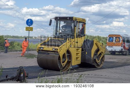 NIZHNY NOVGOROD, RUSSIA June 28, 2017 : Auto appliances communal services of the city. Mechanical machine for compacting new asphalt on the road surface. NIZHNY NOVGOROD