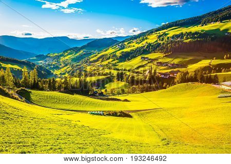 Concept of eco-tourism. The green slope of the mountain. Summer sunset in the Dolomites, Tirol