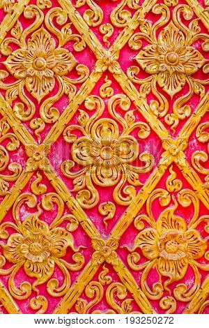 Thai Flower Pattern Embossed Cement Paint With Gold And Red Color Background In Temple.