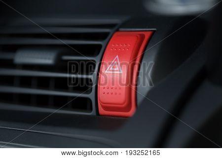 emergency light button control button unit front panel closeup red color.