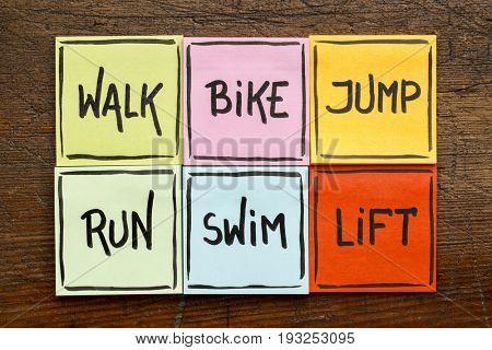 walk, bike, jump, run, swim, life - fitness or cross training concept - handwriting on sticky notes against rustic wood