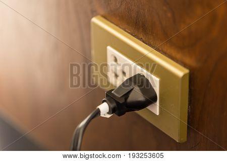 Ac Plug On Wood Wall Vintage Tone.