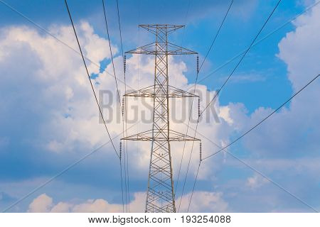 Hight Voltage Electricity cable, capacitor, communication Blue Sky Background.