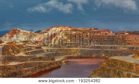 Detailed view of copper mine open pit in Rio Tinto, cloudy day, Spain
