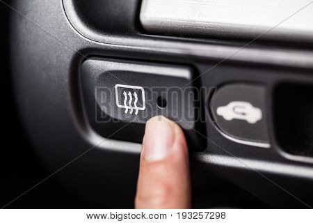 Car heater button with finger press switch on off.