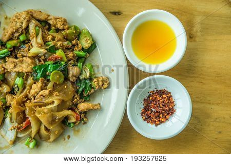 Thai style fried noodle with dried chilly and vinegar chilly is most favorite fast food in most of Thai restaurant.