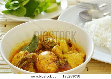 spicy chicken with egg spoiled while being incubated curry and rice
