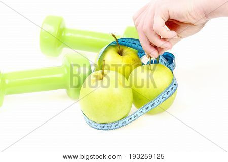 Trio Of Apples Wrapped With Cyan Flexible Ruler In Hands