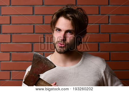 Bearded Guy With Suspicious Look And Cunning Face Expression