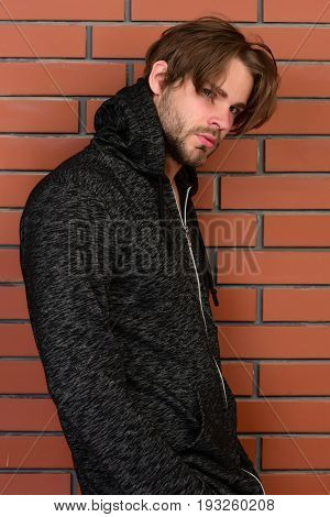 Bearded Young Man With Messy Hair And Grey Hoodie