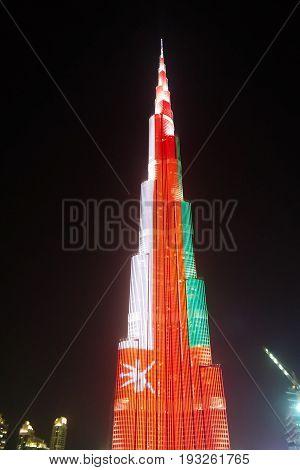 Night view to Burj Khalifa skyscraper in Dubai flag of Oman - 10-01-2015 UAE
