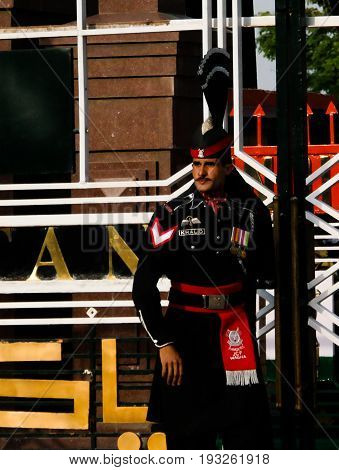 The marching Pakistani guards in national uniform at the ceremony of lowering the flags - 04-05-2015 border between Pakistan and India Wagah Lahore Pakistan