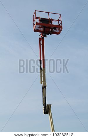 A Very High Extended Arm and Cage of a Cherry Picker.