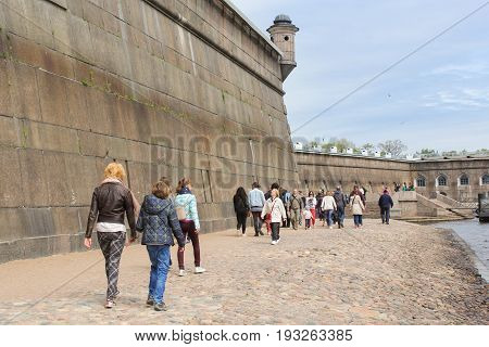 St. Petersburg Russia - 28 May, Tourists at the wall of the Peter and Paul Fortress, 28 May, 2017. Famous sightseeing places of St. Petersburg for tourists.
