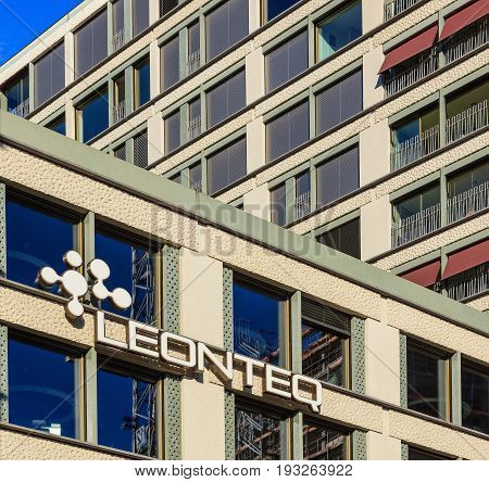 Zurich, Switzerland - 18 June, 2017: partial view of a building bearing the sign of Leonteq on Europallee street. Leonteq AG is an established Swiss company in the finance and technology sector, based on proprietary, high-powered, modern technology.