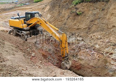 Excavator Working On A Construction Site. Digging The Trench For The Pipeline.