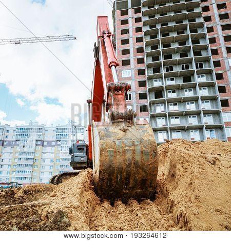 Excavator Rakes Bucket Sand. Construction Work On Site.