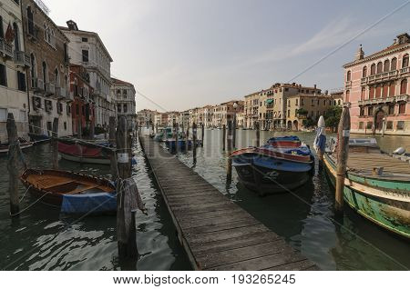 VENICE ITALY - CIRCA 2013: Pier and boats on the Grand Canal in Venice Vento Italy Europe