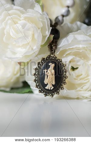 Beautiful Krishna pendant mala beads on flower background.