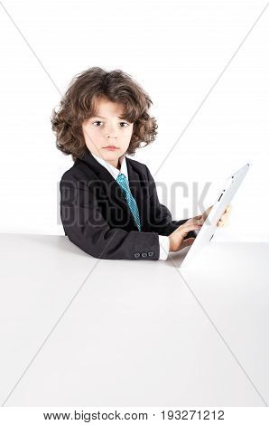 Cute Kinky Businessman Looking At The Camera, Working On The The Tablet. Close-up. White Background.