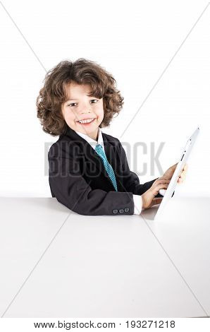 Cute Kinky Businessman Smiling, Looking Into The Camera, Working On The The Tablet. Close-up. White