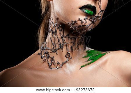Model with decorative creative fashion make up on black background in studio photo. Cosmetics and extravagant makeup